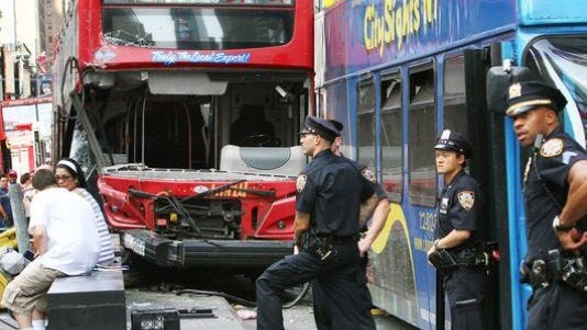 Scene of the accident between two double-decker buses in Times Square that injured 14 people.