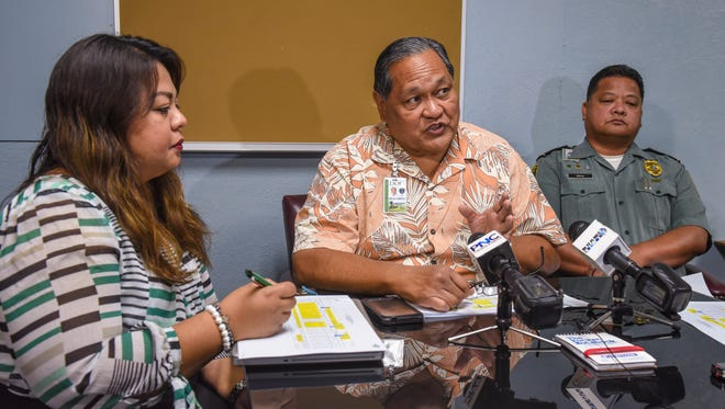 Department of Corrections Director Alberto Lamorena V, center, explains the agency's overtime cost during an informational briefing at the Mangilao correctional facility on Wednesday, April 25, 2018. Joining Lamorena for the briefing are, Deputy Director Kate Baltazar, left, and Prison Warden Alan Borja.
