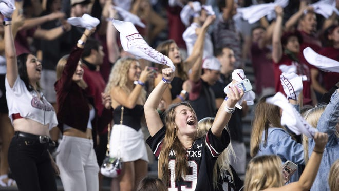 University of South Carolina students cheer before Saturday's NCAA college football game against Tennessee, in Columbia, S.C.