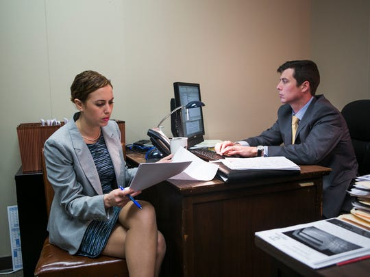 Attorneys Melody Dernocoeur and Phillip Harvey work in an office at the Law Offices of the Shelby County Public Defender at the Shelby County Criminal Justice Center on April 10, 2017. A task force headed up by the state Supreme Court announced sweeping proposals to pour more funds into the provision of lawyers for the poor.