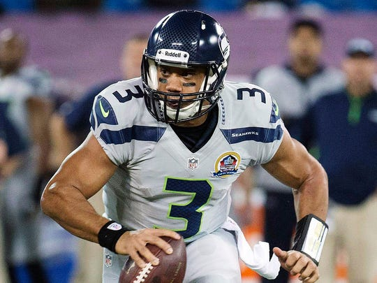"Russell Wilson and the Seattle Seahawks ran Auburn's ""pop pass"" play against the Green Bay Packers."