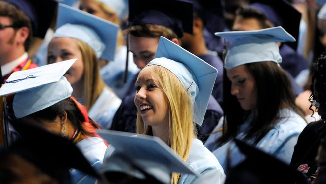 John Jay High School candidate for graduation Ciara Gray has a laugh with members of the graduating class at commencement Friday in the City of Poughkeepsie.