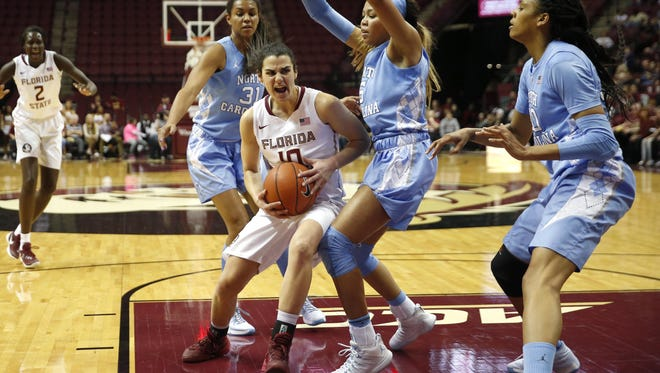 FSU's Leticia Romero drives the ball past North Carolina's Stephanie Watts during their game at the Tucker Civic Center.