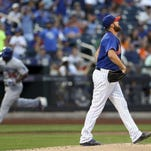 New York Mets starting pitcher Jonathon Niese (49) reacts to giving up a two run home run to Los Angeles Dodgers right fielder Yasiel Puig (66) during the third inning at Citi Field.