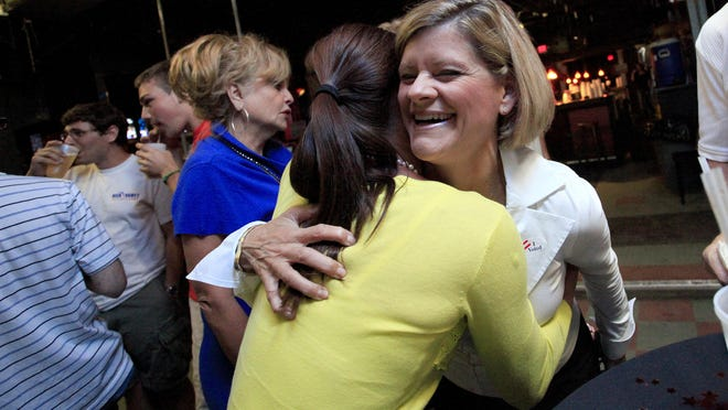 Susan Baird is congratulated by a friend on Nov. 2, 2010 after winning the District 4 seat on the Alachua County Commission, in this Sun file photo.