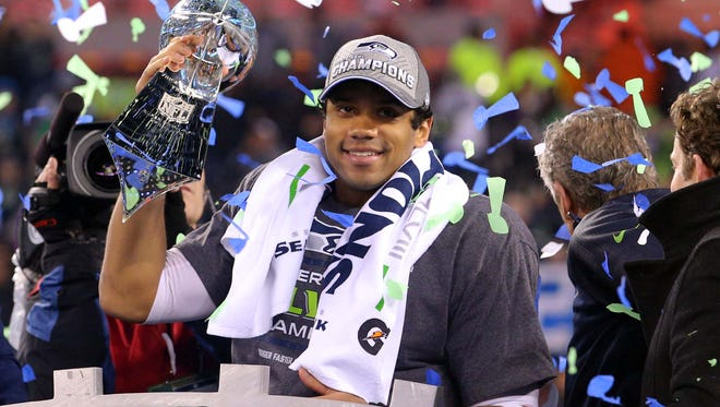Seattle Seahawks quarterback Russell Wilson celebrates with the Lombardi Trophy after beating the Denver Broncos 43-8.