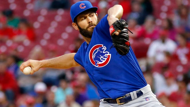 Chicago Cubs starting pitcher Jake Arrieta throws against the Cincinnati Reds during the second inning at Great American Ball Park.