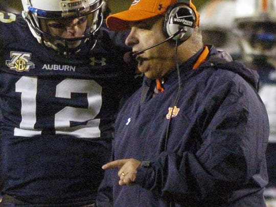 Al Borges, pictured here during the 2007 Iron Bowl with Auburn quarterback Brandon Cox, started his coaching career at Salinas High School in 1975. He's one of eight people that'll be included in the Salinas Valley Hall of Fame Class of 2019.