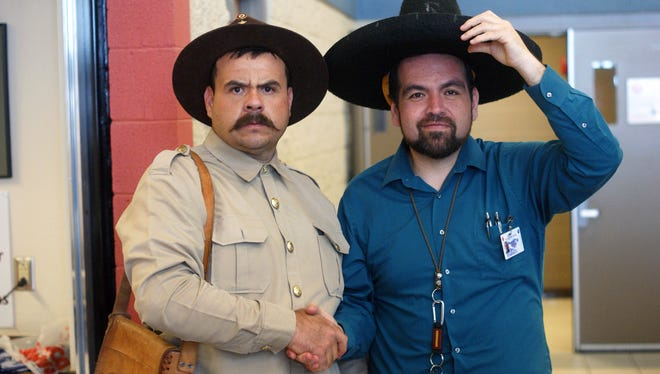 """Principal Armando Chavez, right, of Columbus Elementary School in Columbus, N.M., decided to disarm Mexican revolutionary Francisco """"Pancho"""" Villa, as portrayed by Rafael Celestino, on March 8, 2018, before Villa went to classrooms ahead of the 102nd anniversary of Villa's raid on the border town. The school had been on lockdown for an hour earlier in the day because of gunfire nearby."""