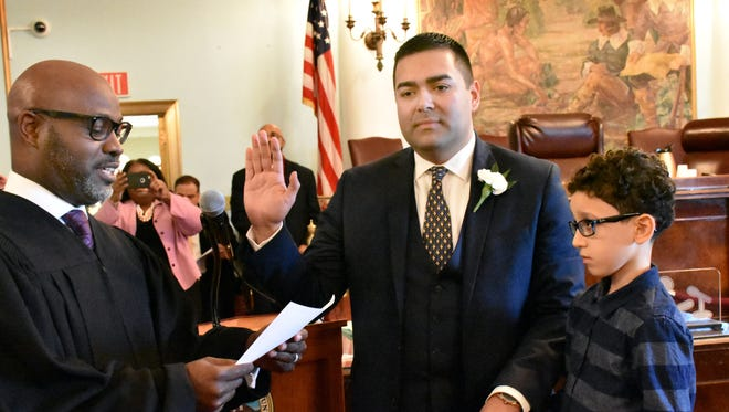 Union County Freeholder Sergio Granados is sworn in as the 2018 chairman of the Union County Freeholder Board by Judge Carl Marshall during Union County Government's 162nd Annual Reorganization on Jan. 7 at the Union County Courthouse in Elizabeth. Holding the Bible for Granados is his nephew, Amir Abuhamoud.
