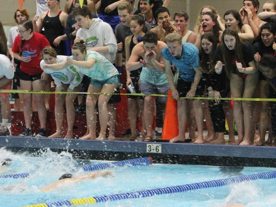 Teammates cheer as South Salem's Tyler Cook (right) and McMinnville's Levi Burres make the final turn in the 400 free relay at the Greater Valley Conference district swimming meet on Saturday, Feb. 13, 2016.