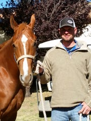 Trainer Trey Wood with Srirracha, a two year old that