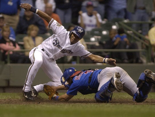 Brewers Alex Sanchez is tagged out at home by Cubs