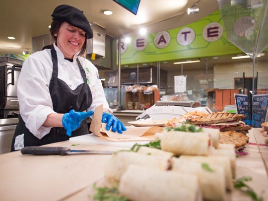 Suzanne Barberot prepares a sandwich for a customer