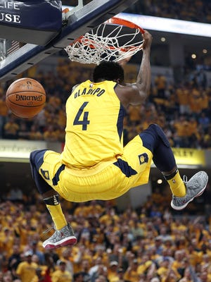 Indiana Pacers guard Victor Oladipo (4) goes up for a slam-dunk during the first half of Game 6 at Bankers Life Fieldhouse on Friday, April 27, 2018.