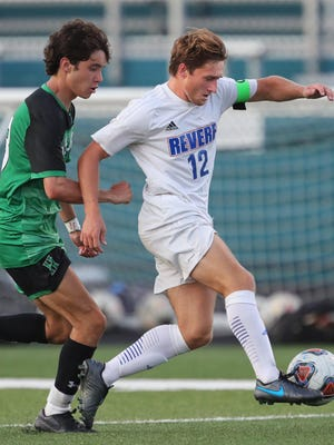 Revere's Tom Buser, right, takes the ball down the field against Highland's Avery Gerney during the first half of a soccer game at Highland High School , Tuesday, Sept. 8, 2020, in Medina, Ohio.