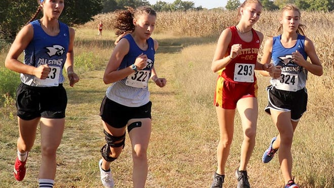 West Franklin girls runners Lily Judd, Emma Bailey and Hope Crabtree finished first, third and fifth in the home meet Thursday at Camp Chippewa. [PHOTO BY MELINDA HANER].