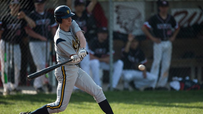 Castle's Zach Messinger bats against Harrison earlier this season. The Knights defeated Memorial Friday to earn a share of the SIAC title with the Tigers.