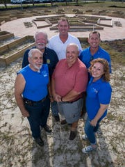Members of the three Rotary clubs of Cape Coral have combined forces to build a community garden next to City Hall. From back left - Donald Vasbinder , Phil Deems Jr., Erik Elsea. From front left - Joe Zagame, Philip Arnold, Amy Rouskey.