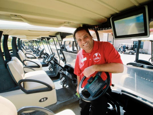 Underwood Golf Complex manager Dallas Cooke shows a golf cart equipped with a Visage GPS, top right, which can be used by golfers to track their position and yardage, as well as many other functions.