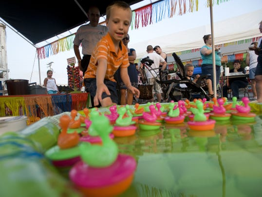 Gettysburg resident Landon Harrison, 5, chooses a duck during the first night of the New Oxford carnival. The fair runs through Saturday night.