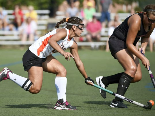 Palmyra's Erin Huffman (18) chases down Britanny Troutman (40) of Hempfield in a 3-1 Palmyra win Friday morning.