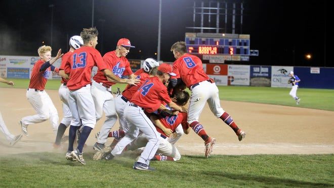 The 4-C ClubSox celebrate after a 5-4 walk-off win over the Fuel to win the Connie Mack City Tournament on Saturday at Ricketts Park.