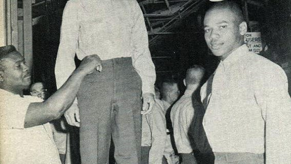 Vernon Harvey, at far right, is fitted for his Marine uniform. The photo is from the 1968 Marine Corps Recruit Depot in San Diego, California. He died at the VA Medical Center in Corryville on March 31, 2008.