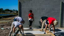 Team employees and alumni helped build houses in Immokalee while donating $400,000 from the NHL