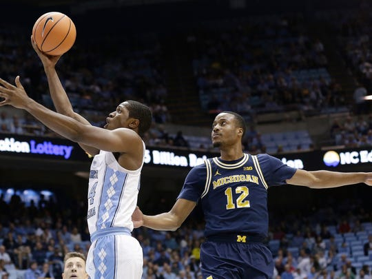 North Carolina's Kenny Williams drives to the basket