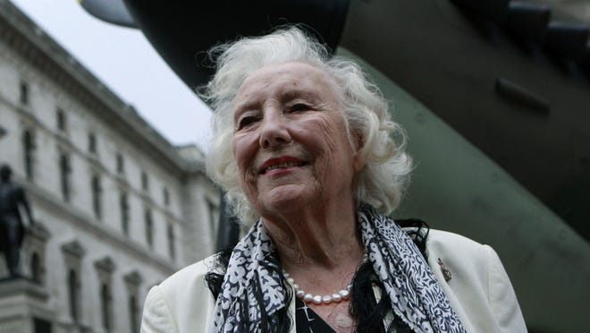 FILE - In this Friday Aug. 20, 2010 file photo, Dame Vera Lynn attends a ceremony to mark the 70th anniversary of the Battle of Britain. in central London. Britain has taken a nostalgic trip into the past on Monday March 20, 2017, to celebrate the 100th birthday of patriotic songstress Vera Lynn by projecting her image onto the white cliffs of Dover.