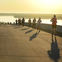 By the dawn's early light:400 up early for Marco Island Half Marathon 'Bridge Run' and 5K