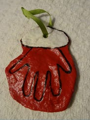 "A dough ornament made by Leigh Grainger with Savannah Faye's ""help""."