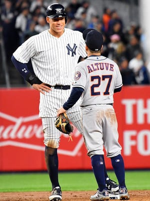 Yankees' Aaron Judge talking with Astros second baseman Jose Altuve during Game 3 of the 2017 ALCS at Yankee Stadium.
