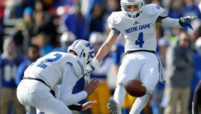 Green Bay Notre Dame's Vinny Pallini (4) kicks a 40-yard field goal against Waukesha Catholic Memorial during the WIAA Division 3 state championship game at Camp Randall Stadium in Madison on Nov. 20, 2015. Pallini is one of 23 local players competing in the WFCA All-Star Classic on Saturday at Titan Stadium in Oshkosh.