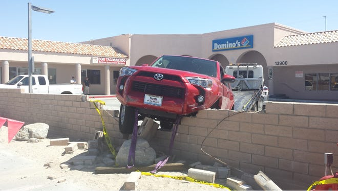 An SUV hit a wall on Palm Drive Thursday morning