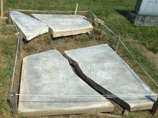 The gravestone of James Kent is shown during the restoration process.