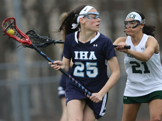 Lexi Edmonds, of IHA, controls the ball against Kaitly Skamas and Ramapo, Thursday, April 12, 2018.  IHA went on to win the game, 13-4.