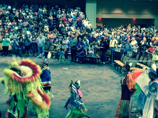 The crowd watches the colorful Grand Entry of performers Saturday afternoon at the Tunica-Biloxi Pow Wow in the Earl J. Barbry Sr. Convention Center at Paragon Casino Resort in Marksville. The Pow Wow continues Sunday.