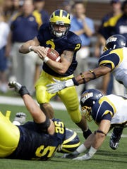 Michigan running back Sam McGuffie on a rush against Toledo in Ann Arbor on Saturday, Oct. 11, 2008. U-M lost, 13-10.