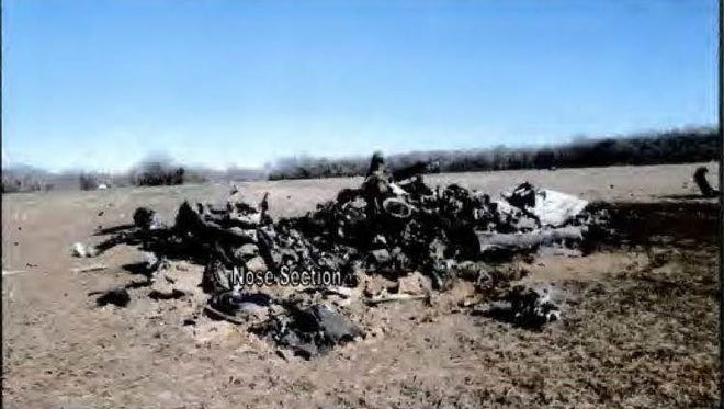 The fuselage of the helicopter hit the ground and burst into flames on Dec. 2, 2015.