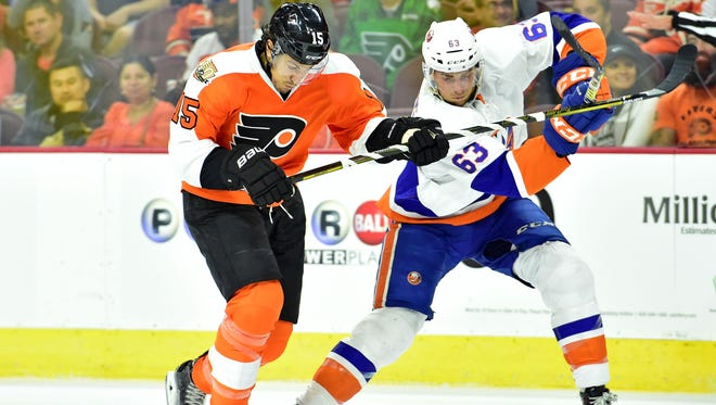 "Flyers defenseman Michael Del Zotto, left, will miss at least a month with what the team calls a ""lower-body injury."""