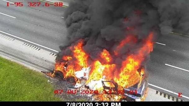 A semi-truck is engulfed in flames on Interstate 95 in St. Johns County. [CONTRIBUTED
