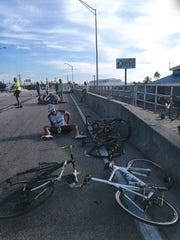The aftermath of a July crash that injured five cyclists in Fort Myers Beach. The driver looks on as one of the cyclist tries to keep the most seriously injured cyclist alive. The crash was the impetus for a statewide bill to make drivers more accountable for harming vulnerable users.