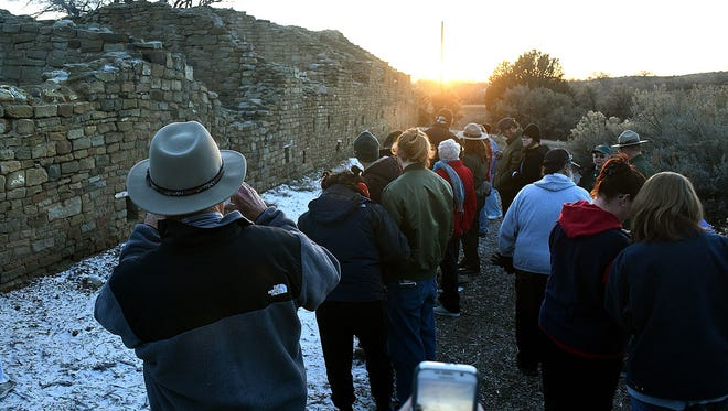 The setting sun aligns itself with the north wall of the West Ruin great house at Aztec Ruins National Monument on Dec. 21, 2016, during an event to mark the winter solstice.