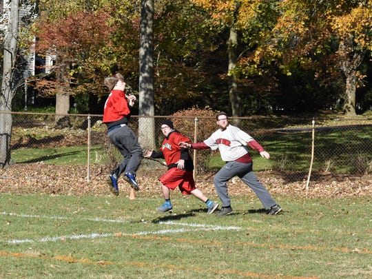 A local pickup football game between friends and family in Ridgewood has been a tradition since the late 1970s.