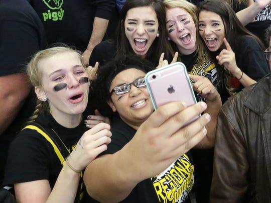 Student fans of the Waupun boys' basketball team celebrate