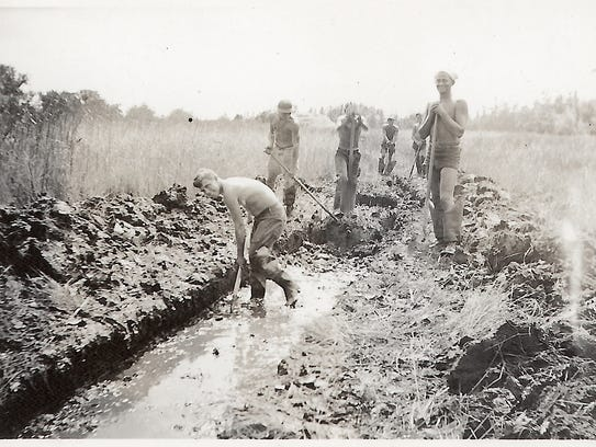 Members of the Civilian Conservation Corp dig ditches on the Delmarva Peninsula in August 1935. The channelization of the Pocomoke River was among the many drainage projects implemented in the mid-1900s to create new agricultural lands on Maryland's Eastern Shore.