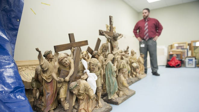 John Kalitz, Diocese of Camden Director of Business Solutions, walks by the Stations of the Cross from Immaculate Heart in Woodlynne, now stored in a diocese facility.