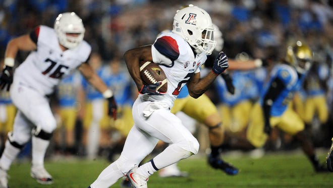 October 1, 2016; Pasadena, CA, USA; Wildcats wide receiver Tyrell Johnson (2) runs the ball against the Bruins during the first half at Rose Bowl.